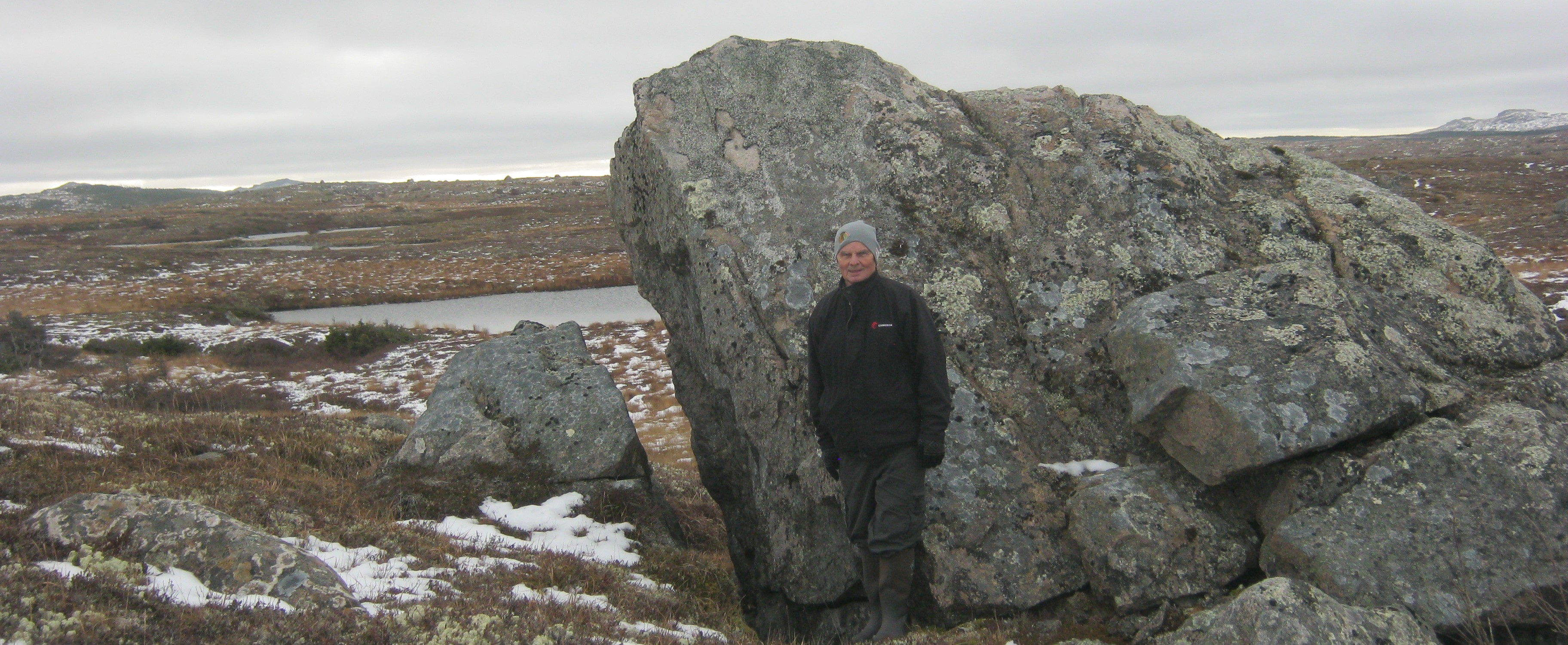 The author standing by Split Rock